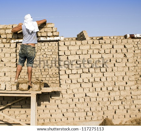 The new house, built of clay blocks, a specialist master