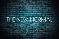The New Normal. Neon light lettering  on brickwall background. New normal after covid-19 pandemic Background concept for poster, social network, banner, cards.