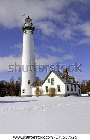 The New Presque Isle stands tall on a cold winter's day. The Lighthouse is located just outside of Alpena, Michigan, USA.