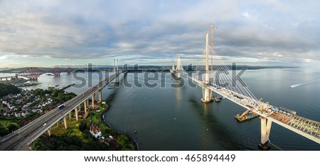 stock photo the new queensferry crossing bridge on the right under construction over the firth of forth with 465894449 - Каталог — Фотообои «Мосты»