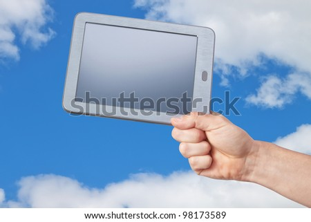 The new tablet in his hand against the sky.