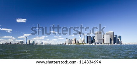 The New York City and New Jersey skyline at afternoon w the Freedom tower and Brooklyn bridge