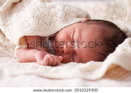 The newborn sleeps on a light blanket. The kid is 10 days old. Childhood, infancy and people concept Stock photo ©
