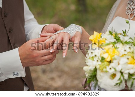 The newlyweds, Wedding rings on fingers, Hands close-up #694902829