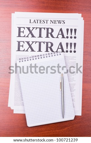 The newspaper LATEST NEWS with the headline EXTRA! EXTRA! and notepad and notepad