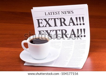 The newspaper LATEST NEWS with the headline EXTRA! EXTRA! on table