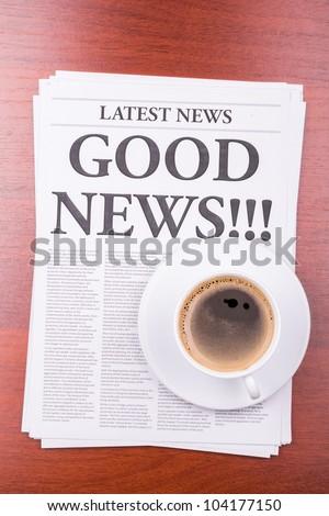 The newspaper LATEST NEWS with the headline GOOD NEWS  and coffee