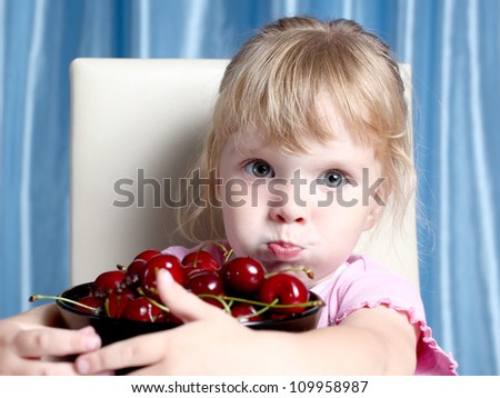 the nice girl and is a lot of cherry in a plate
