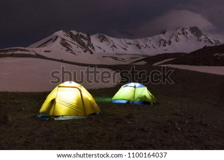 The night before the ascent - the tents of tourists shine at the foot of Erciyes Dag in central Anatolia, Turkey. #1100164037