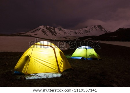The night before the ascent - the tents of tourists shine at the foot of Erciyes Dag in central Anatolia, Turkey. #1119557141