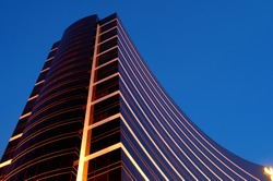 The night scene of commercial building over blue sky