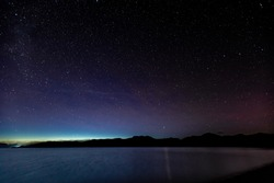 the night sky above loch linnhe in the argyll region of the highlands of scotland during a clear dark sky night in winter