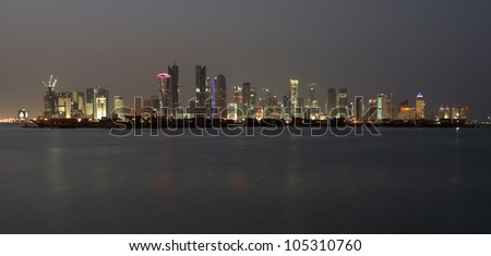 The night skyline over the persian gulf of the city of Doha, Qatar