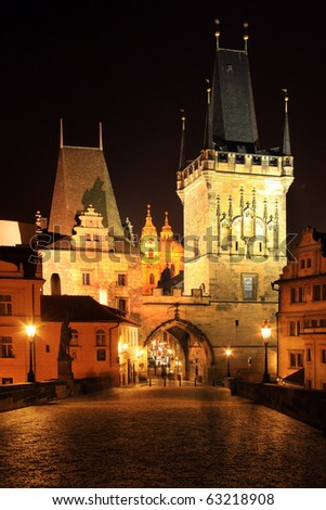The night View on bright Prague St. Nicholas' Cathedral with Bridge-Tower