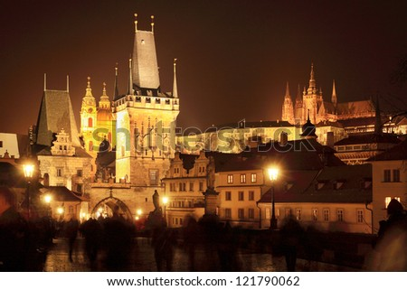 The night View on Prague Lesser Town with St. Nicholas' Cathedral, Bridge Tower and gothic Castle, Czech Republic