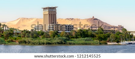 The Nile at Aswan and the West Bank with Tombs of the Nobles (from the Old and Middle Kingdom). There is Qubbet el-Hawa - 'Dome of the Winds' (tomb of a Muslim prophet) at the crest of the hill