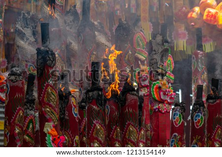 The Nine Emperor Gods Festival, Burning of large joss stick to worship god during the festival. Smoke from the burning incenses for worshipping. Incense sticks in a Chinese temple.