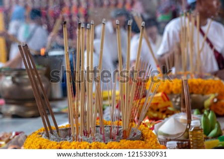 The Nine Emperor Gods Festival, The Vegetarian Festival. Burning of joss stick to worship god during the festival. Smoke from the burning incenses for worshipping. Incense sticks in a Chinese temple.