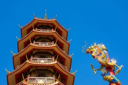 The nine-story chinese pagoda and the dragon's head, high up in the blue sky
