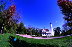 The 1888 North Point Lighthouse in Milwaukee Wisconsin imaged with a fish eye lens for a special effect on the image.  The tower is made of steel and has flat sides or facets creating a unique style.