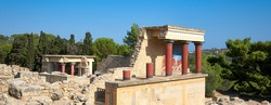 The North Portico in Knossos, Crete, Greece. Bronze age excavations of Knossos town on the greek island of Crete. Panoramic banner image with blue sky.
