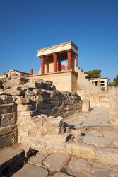 The North Portico in Knossos, Crete in Greece. Excavations of Knossos town is the biggest Bronze Age archaeological site on the island of Crete in Greece..
