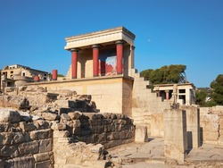 The North Portico in Knossos, Crete in Greece. Excavations of Knossos town is the biggest Bronze Age archaeological site on the greek island of Crete or Creta.