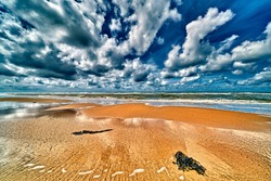 the north sea beach with clouds and  sun , wide angle view of the nordsea