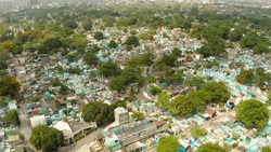 The northern cemetery in Manila with many graves and crypts in the city center aerial view. Travel concept.