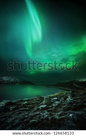 The Northern Lights (aurora borealis) as seen from Northern Norway. Contains Noise.