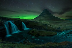 The Northern Lights (aurora borealis) in Kirkjufell Mountain in Iceland
