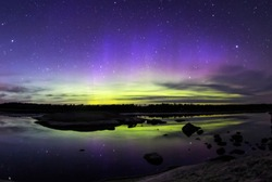 The northern lights shining over the waters of Voyageurs National Park from the Ash River Visitor Center (Minnesota), May 5, 2018.