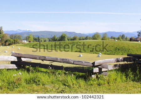 The Northshore Mountains overlooks farmland in British Columbia's Fraser Valley/Scenic Farmland/Farmland in British Columbia's Fraser Valley