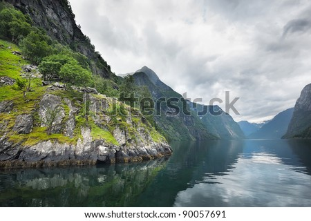 The Norwegian fjord in the summer in cold cloudy weather