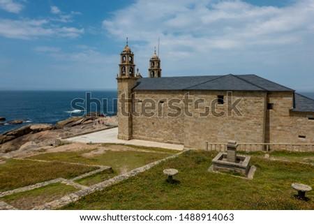The Nosa Señora da Barca Church is located on the rocky Cape ' Coast of Death' (Costa de Morte) near the town of Muxia. Zdjęcia stock ©