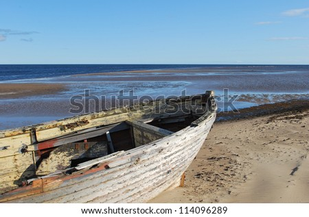 The nose of the old boat on the beach