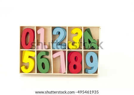 The Number Card Made Of Wood Colored With Variety Color Over Background