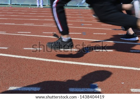 The number of athletes and the track on the runway