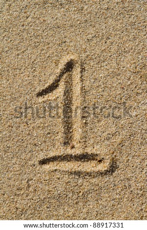 The number one drawn in the sand