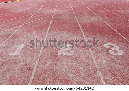 The number sign 123 on an athletic running track lane.