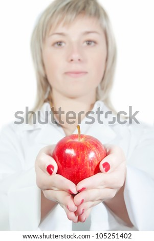 The nurse girl holds an apple