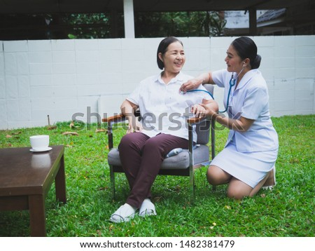 The nurse is caring for the elderly with happiness,doctor with a stethoscope take care elder woman