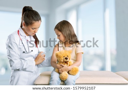 The nurse is injecting for female students in a primary school.