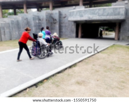 The nursing staff pushed the wheelchair to the entrance (intentional shooting blur) Taiwan #1550591750