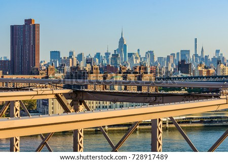 The NYC midtown skyline with the Empire State Building from the Brooklyn Bridge just after sunrise, New York, USA #728917489