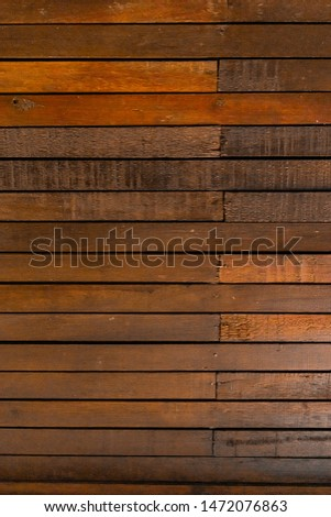The oak woods are arranged for wall. There are brown, light brown and dark brown colours. Can use as a background or wallpaper or backdrop.