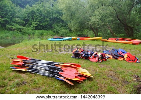 the oars from the canoes on the shore, preparing for the Canoeing