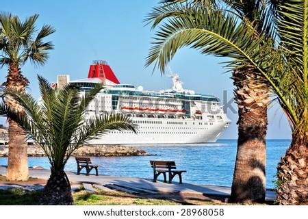 The ocean liner, standing near a pier on Aegean sea, Turkey
