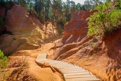 The Ochre Path le Sentier des Ocres through the Red Cliffs of Roussillon Les Ocres, a nature park in Vaucluse, Provence, France.
