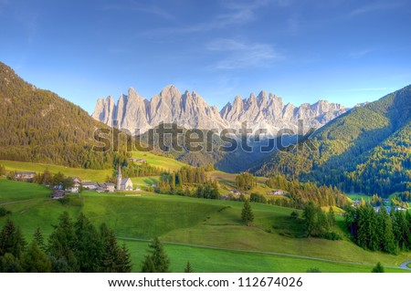 The Odle Mountain Peaks and the Church of Santa Maddalena, Dolomites Ranges, South Tyrol, Italy